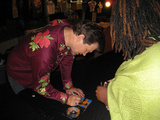 Chris Isaak signing a CD for Natalee